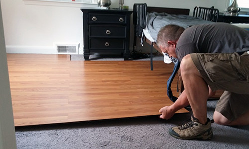 Normally, a floating laminate floor does not require any glue to remain  stable; the walls of the room keep the planks secure. - Temporary Wheelchair Accessible Flooring Accessible Housing Services